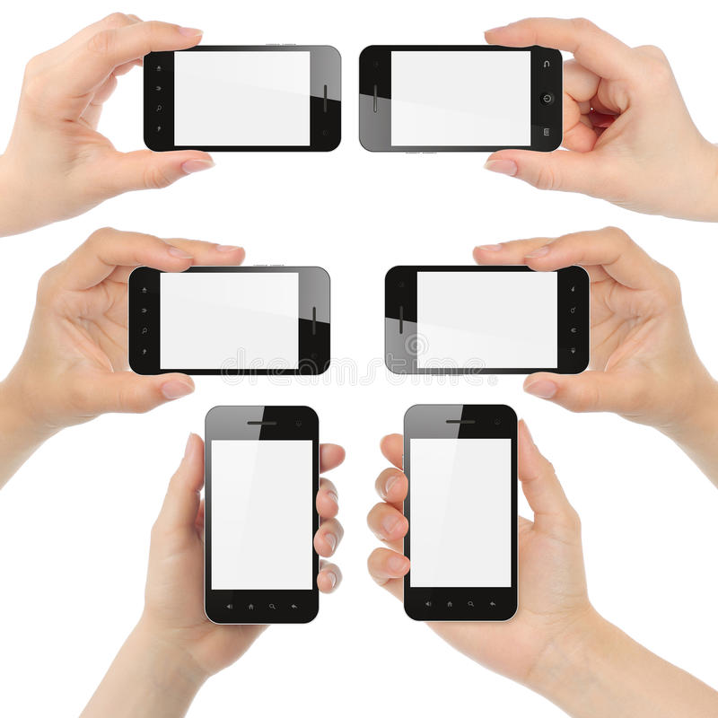 拿着巧妙的电话的手 免版税库存图片