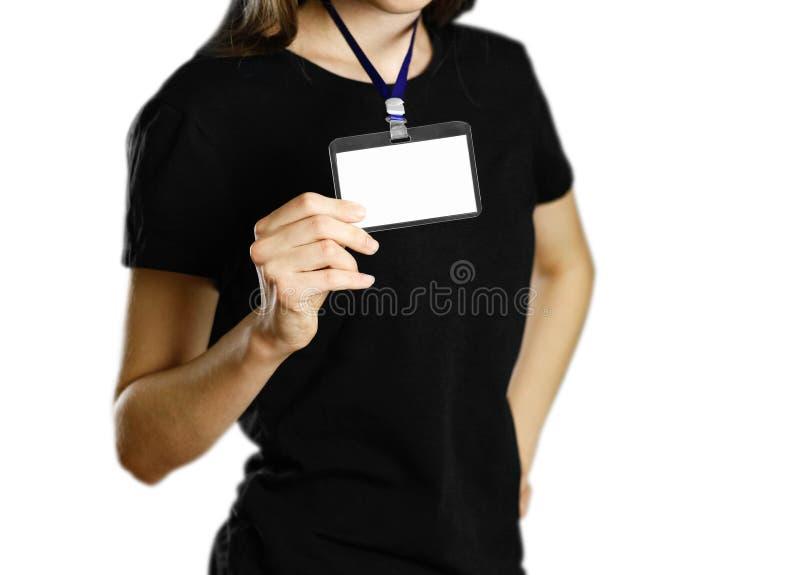拿着徽章的女孩 关闭 被隔绝的背景 免版税图库摄影