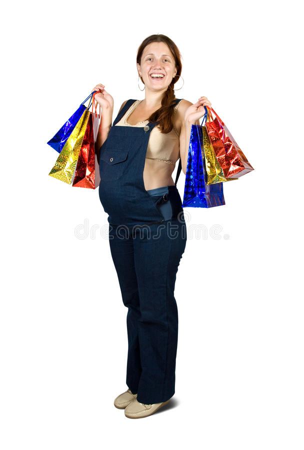 拿着怀孕的购物妇女的袋子 库存图片