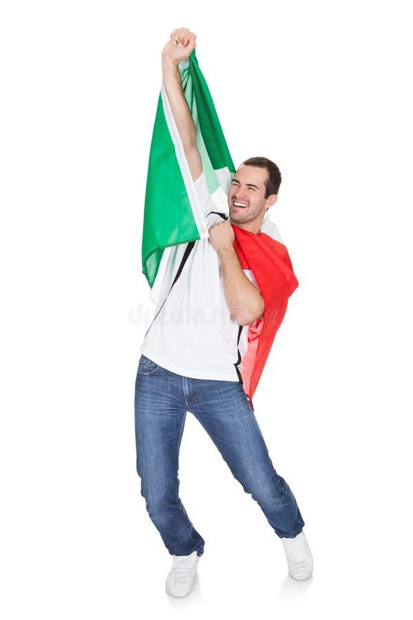 拿着意大利标志的一个愉快的人的纵向 免版税图库摄影