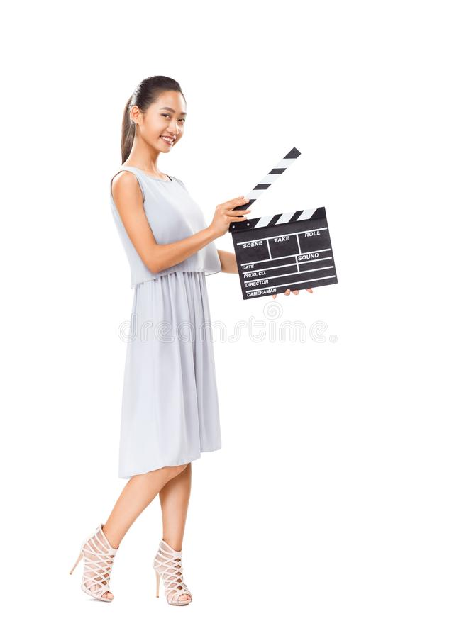 拿着戏院拍板的美丽的年轻亚裔妇女被隔绝 库存照片