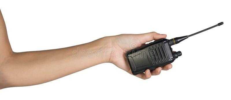 拿着手提电话机发射机的女性手 库存图片