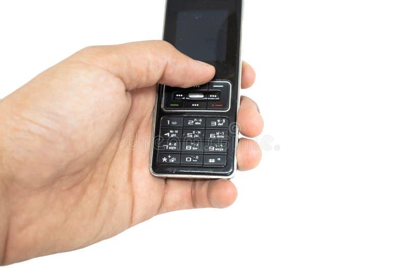 拿着手机的老一代手指有白色孤立冲切的背景 免版税图库摄影