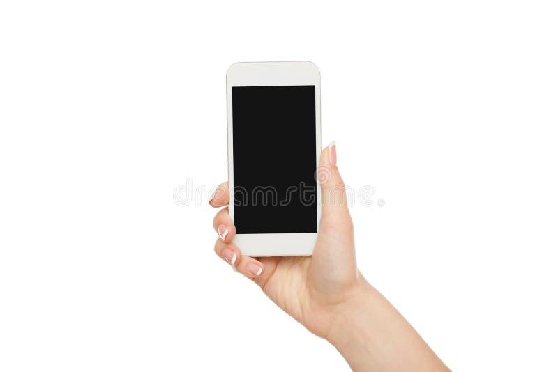拿着手机,庄稼的女性手,删去了 免版税库存照片