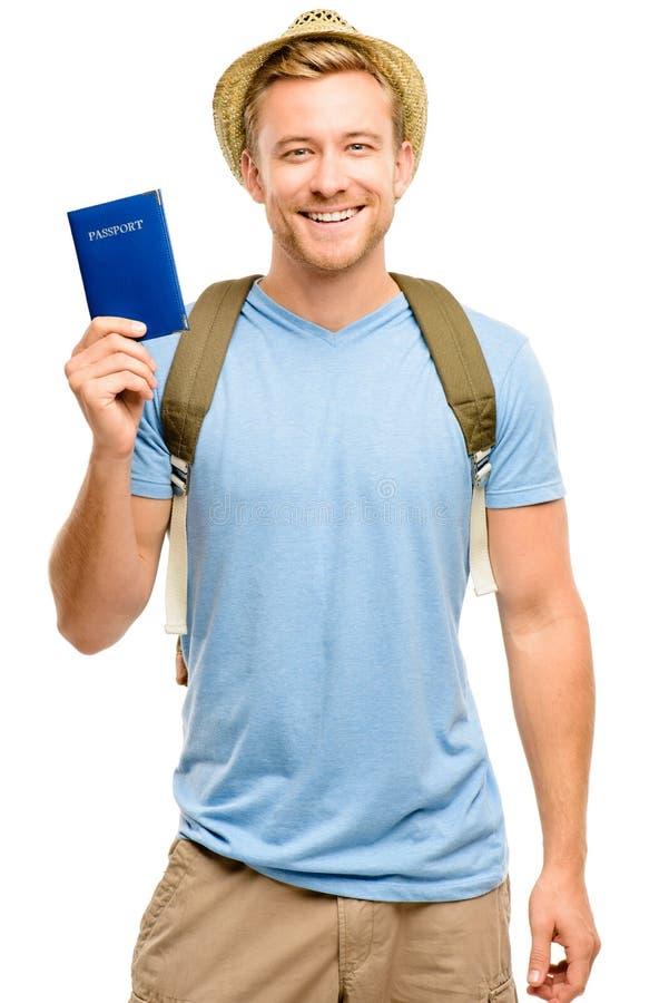 拿着护照白色背景的愉快的年轻旅游人 库存照片