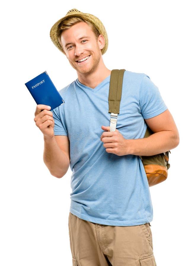 拿着护照白色背景的愉快的年轻旅游人 免版税库存照片