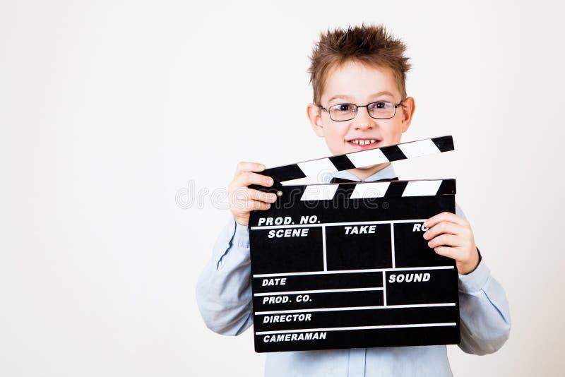 拿着拍板的男孩 免版税库存照片