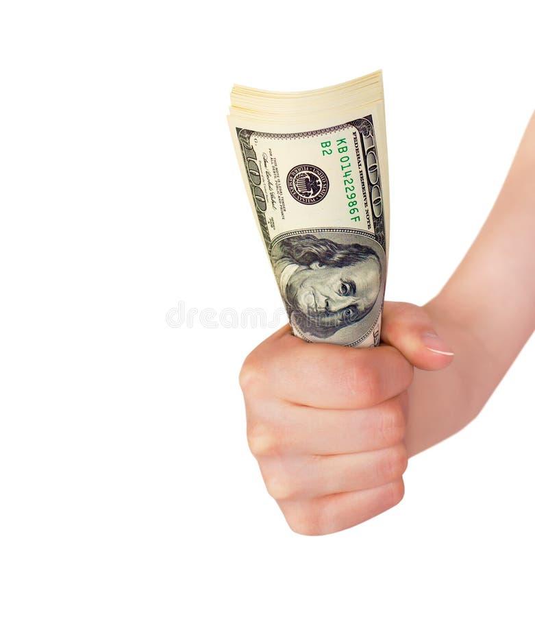 拿着捆绑金钱的手 免版税库存照片