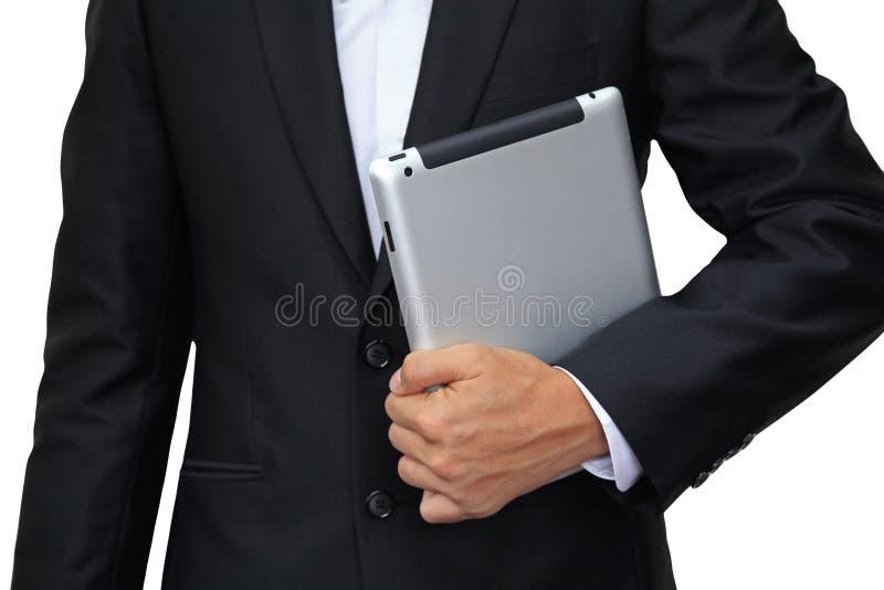 拿着数字式片剂的商人查出在白色 免版税库存照片