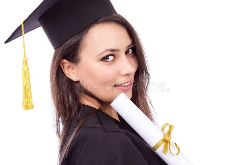 拿着文凭的毕业褂子的美丽的女学生 库存照片