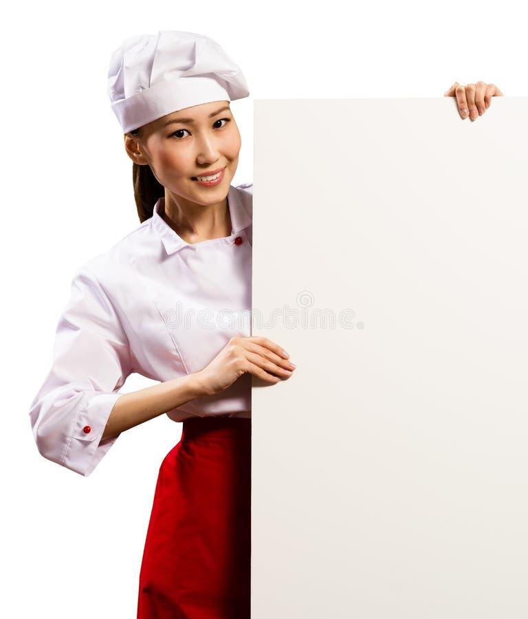 拿着文本的女性厨师一张海报 库存图片