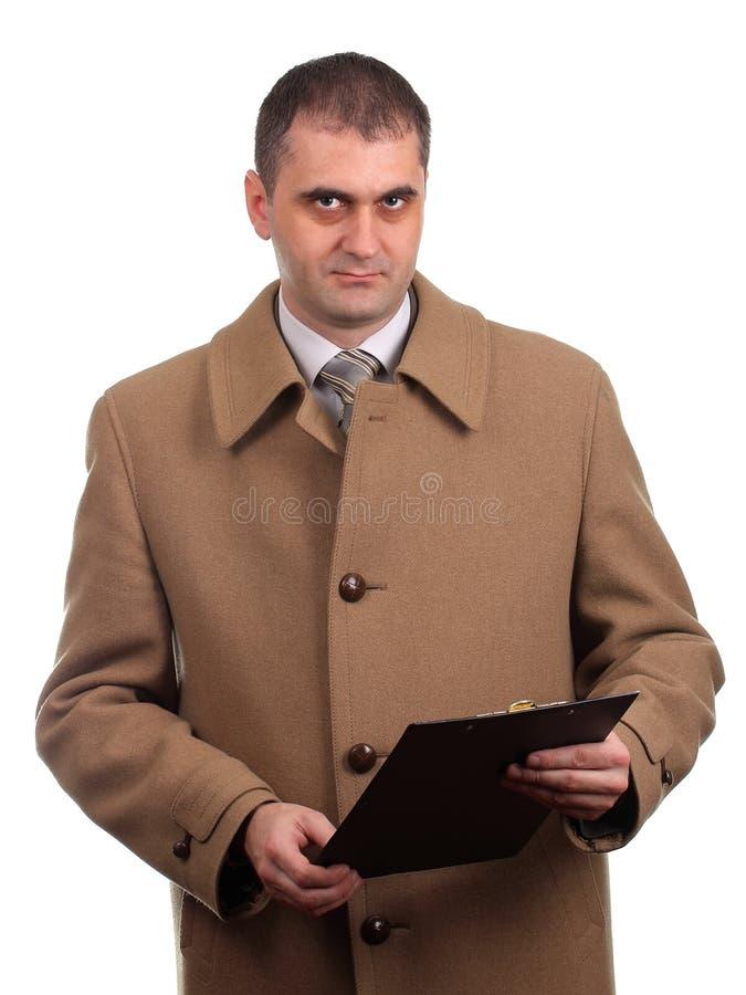 拿着文件夹的严肃的商人 免版税库存照片