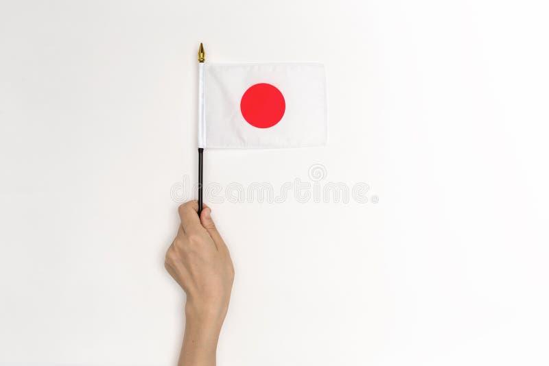 拿着日本旗子的人 免版税库存照片