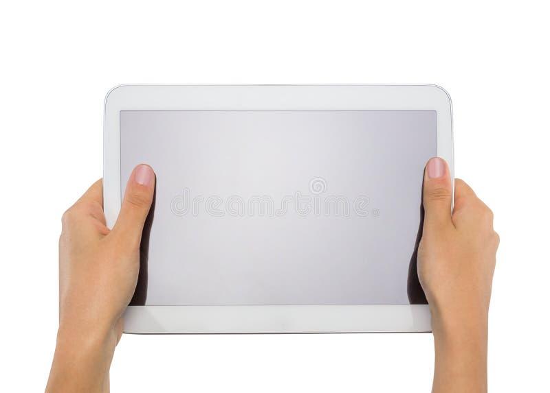 拿着普通片剂个人计算机的女性青少年的手 免版税库存照片