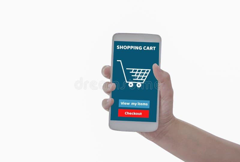 拿着智能手机在有说的手上的妇女用车运送产品在网上购买网上被隔绝的白色背景,与购物 免版税库存图片