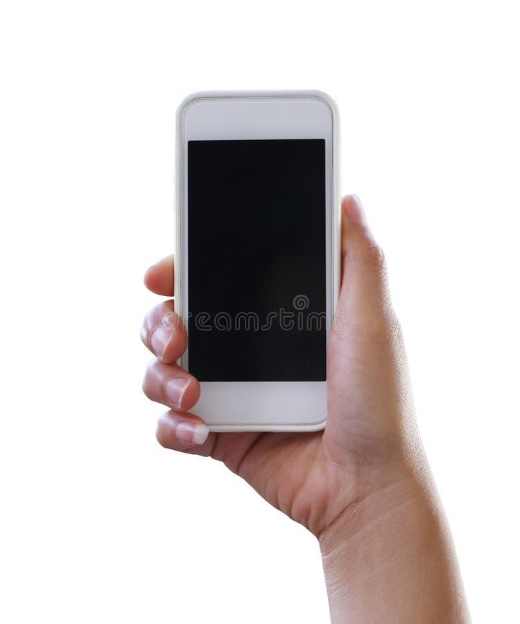拿着智能手机的妇女的手被隔绝在白色背景 免版税库存照片