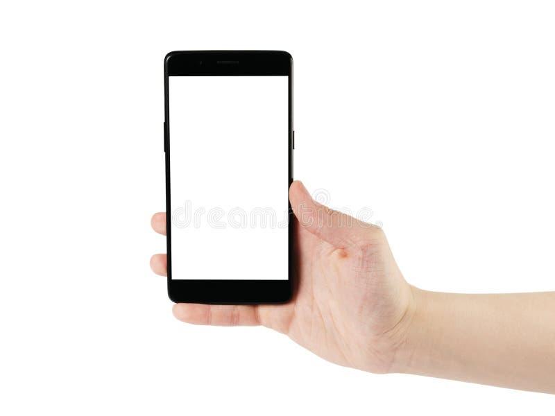拿着智能手机的年轻人手被隔绝在白色 免版税库存照片