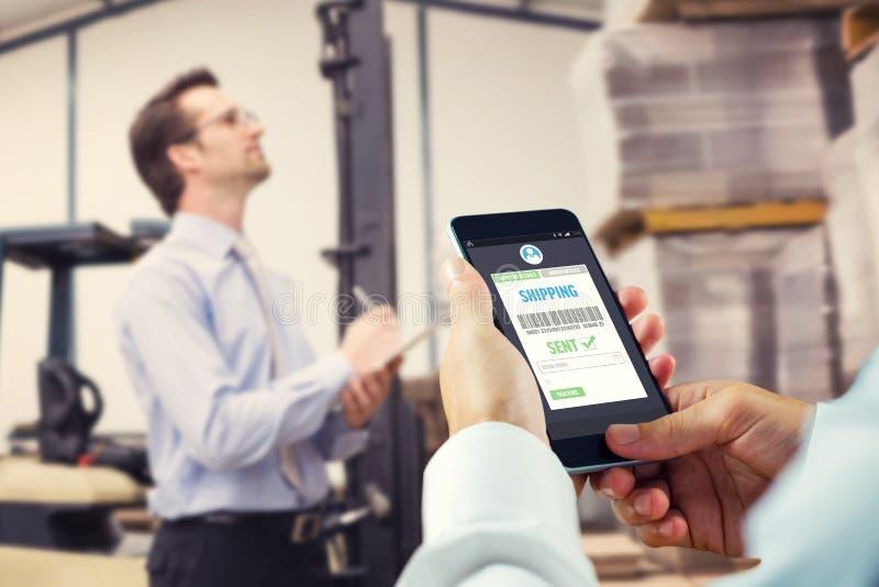 拿着智能手机的手的综合图象 免版税库存照片