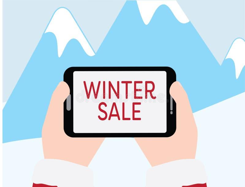 拿着有冬天销售文本的手片剂在蓝色山有雪背景 库存例证