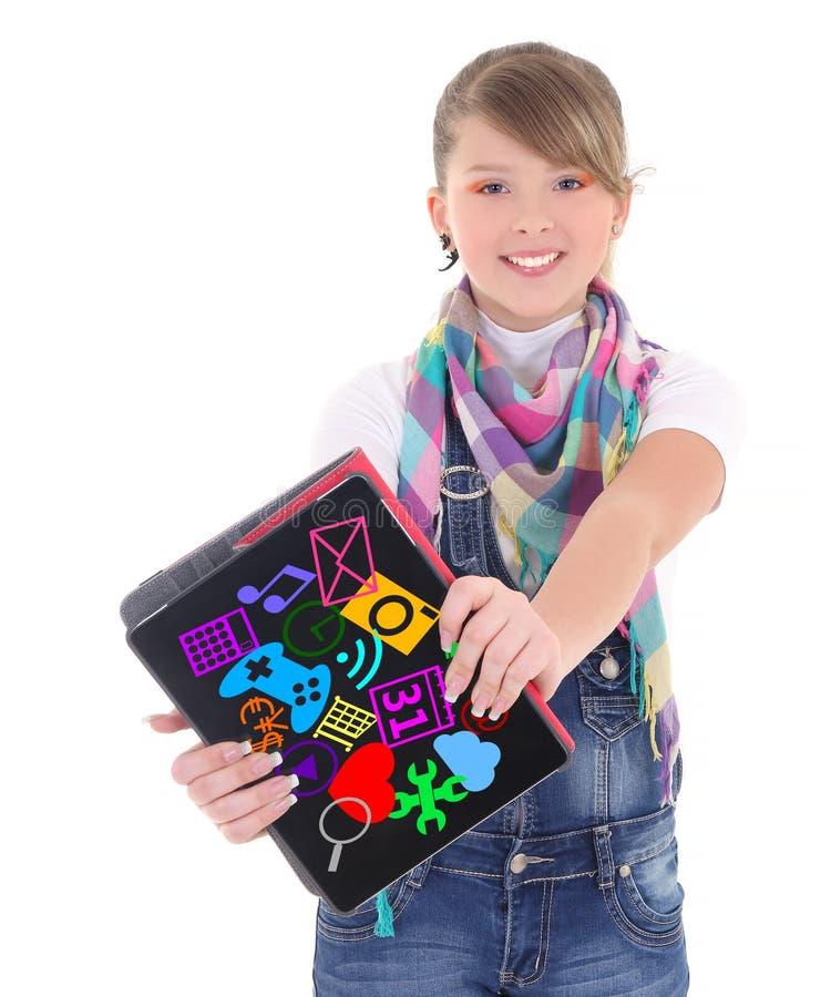 拿着有多媒体应用象的十几岁的女孩片剂个人计算机 免版税库存照片