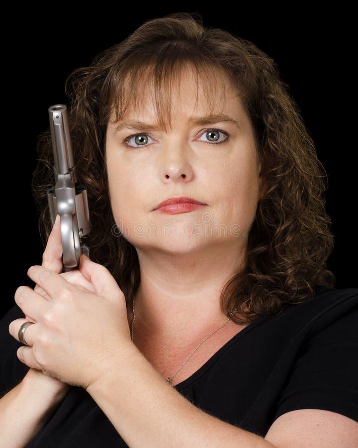 拿着有子弹的枪的妇女 图库摄影