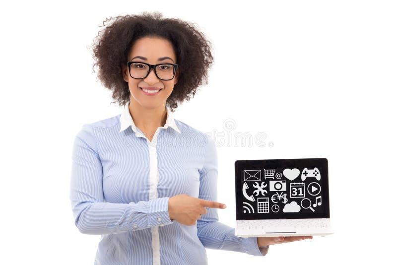 拿着有我的美丽的非裔美国人的女商人膝上型计算机 库存照片