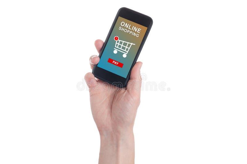 拿着有手提篮的手机和在屏幕上的人的手薪水按钮 流动付款概念 网上和流动 库存照片