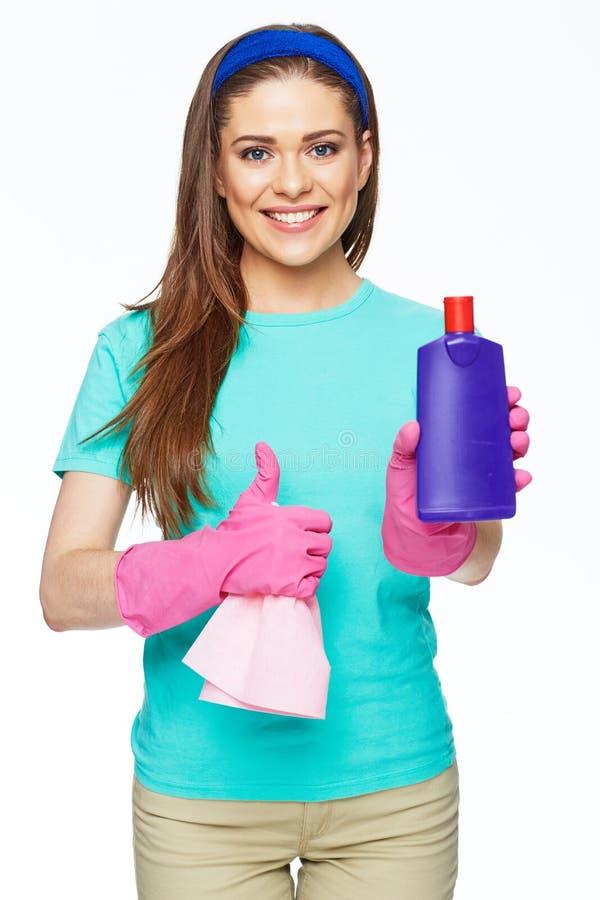 拿着有更加干净的液体和展示的t的管家妇女瓶 库存照片