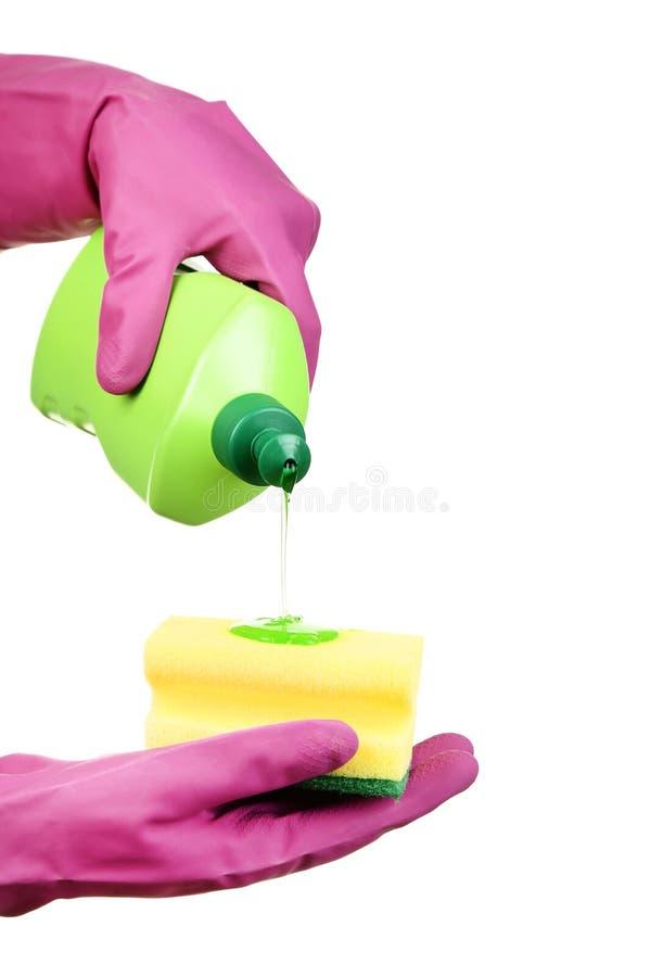 拿着有洗涤剂的手瓶 免版税图库摄影