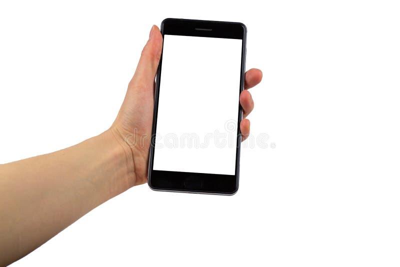 拿着有空的空白的屏幕的女性手流动智能手机隔绝在白色背景 事务,技术 免版税库存图片