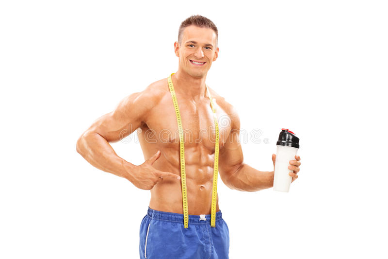拿着有蛋白质震动的运动员一个瓶 库存照片