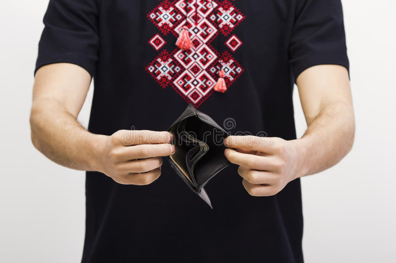 拿着有金钱的人一个钱包 库存图片