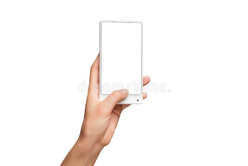 拿着有黑屏的女性手大模型现代白色手机 免版税库存照片