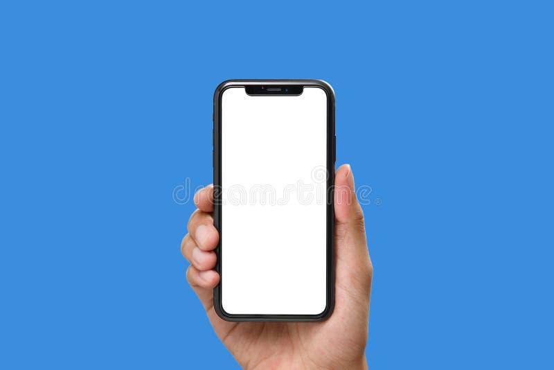 拿着有黑屏的手黑智能手机 图库摄影