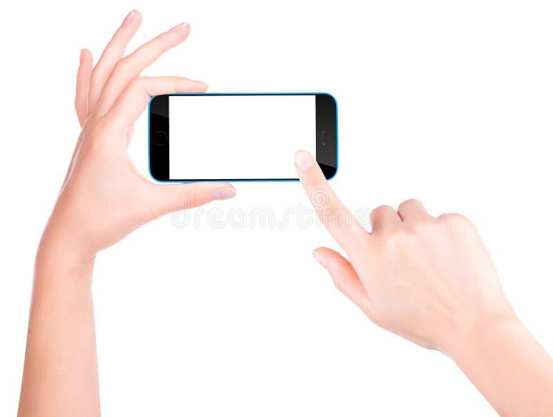 拿着有黑屏的手黑智能手机 免版税库存照片