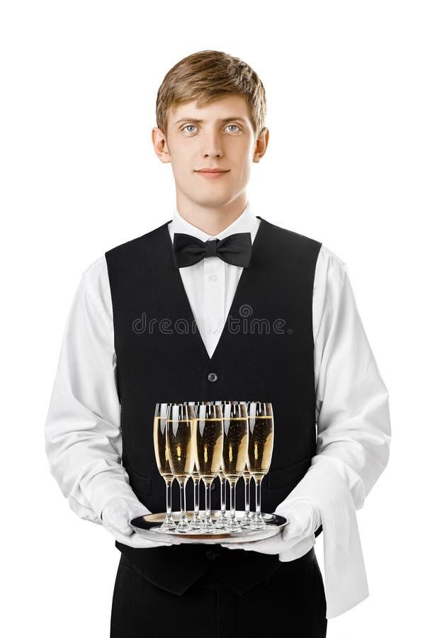 拿着有玻璃的英俊的侍者画象银色盘子  库存图片