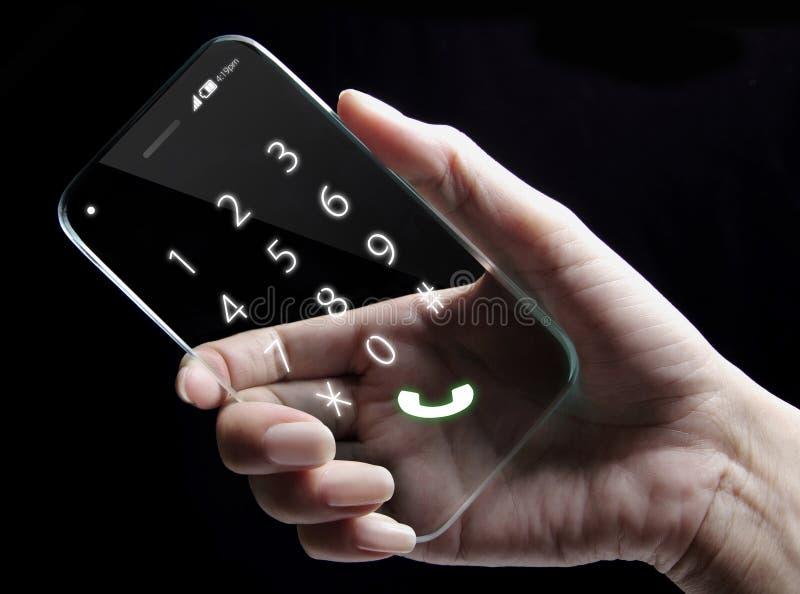 拿着未来派透明智能手机的手 库存图片