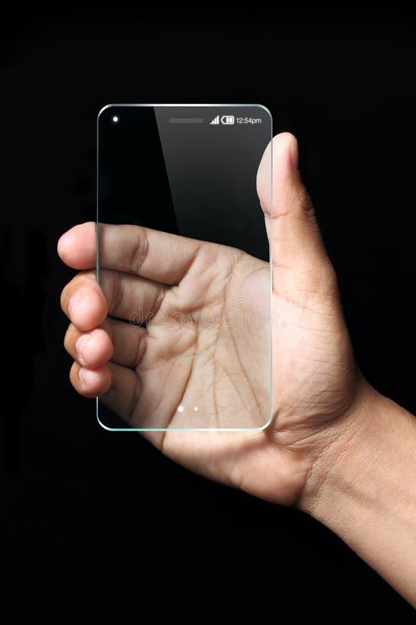 拿着未来派透明智能手机的手 免版税库存图片