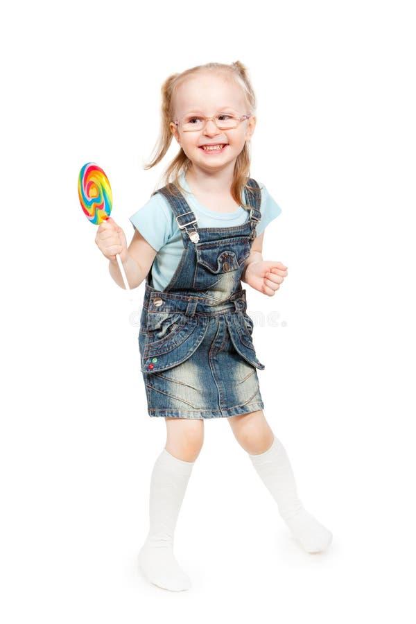 拿着棒棒糖的小女孩 图库摄影