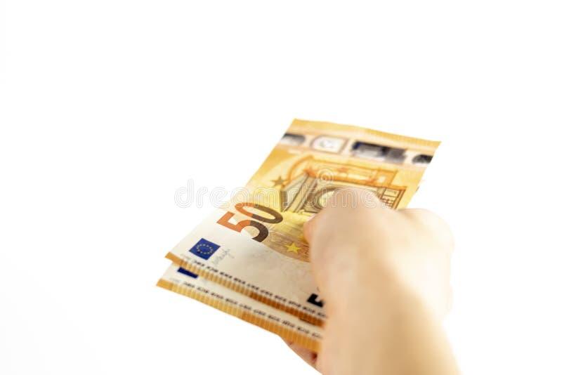 拿着欧元钞票的一只无法认出的妇女手的播种的射击 库存图片