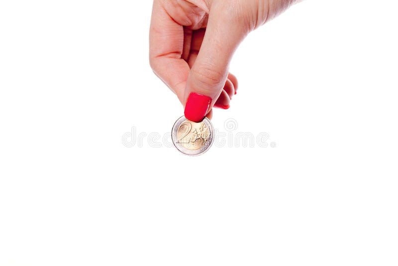 拿着欧洲硬币的妇女手 免版税库存照片
