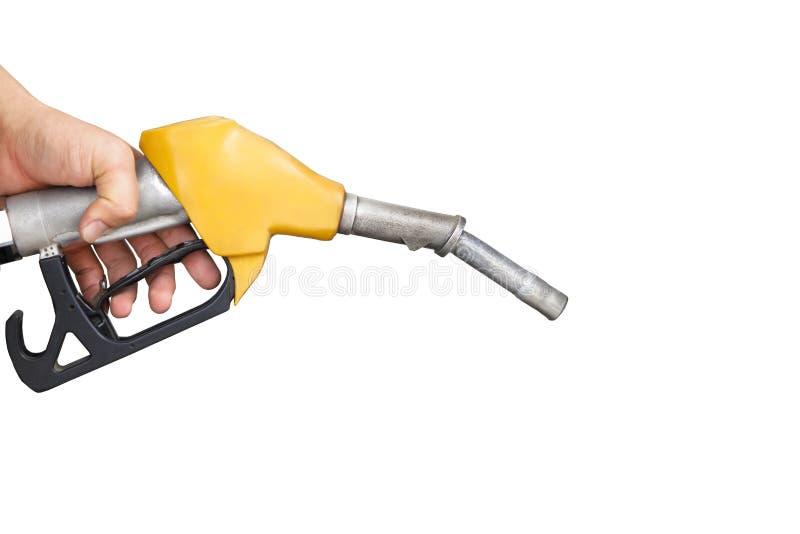 拿着气泵喷管的手 免版税图库摄影