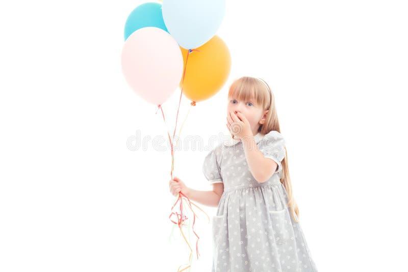 拿着气球的宜人的女孩 免版税图库摄影
