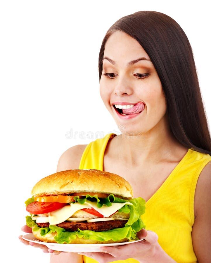 拿着汉堡包的妇女。 免版税库存照片