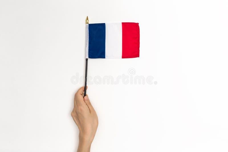 拿着法国旗子的人 免版税库存照片