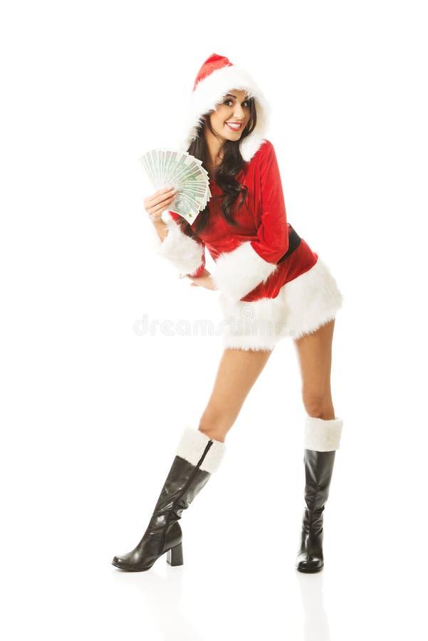 拿着波兰金钱的夹子全长圣诞老人妇女,站立跨着 免版税库存图片