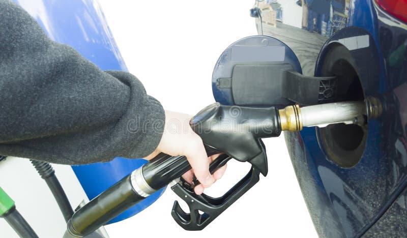 拿着燃油泵的手 免版税库存图片