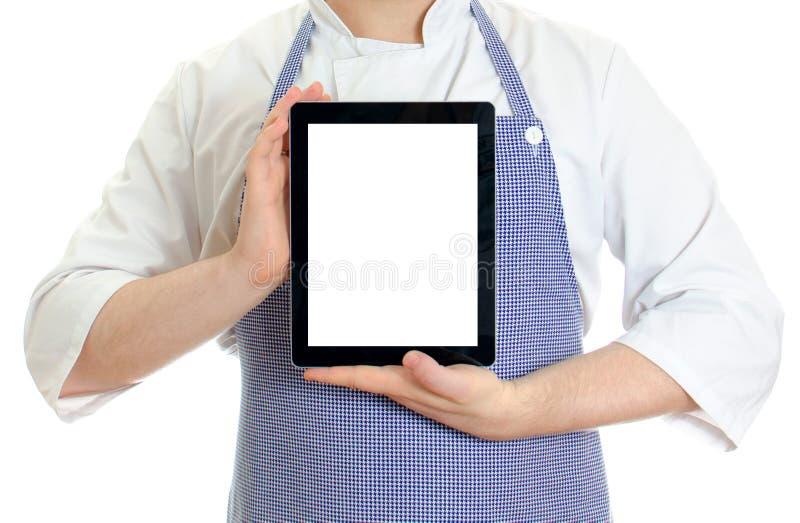 拿着片剂个人计算机的男性主厨厨师现有量。 库存照片