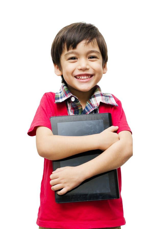 拿着片剂计算机触摸屏的小男孩 图库摄影