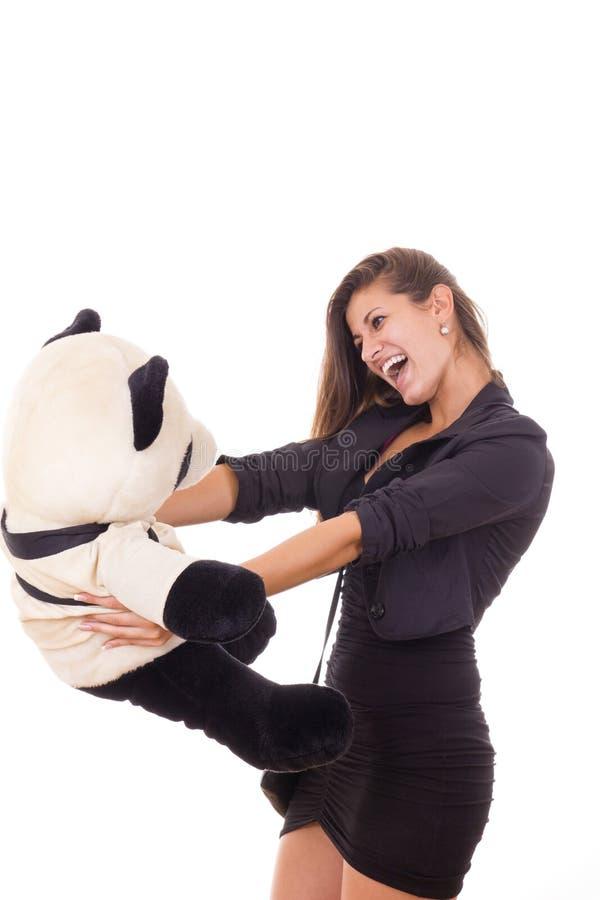 拿着玩具熊的兴奋的女商人 库存照片